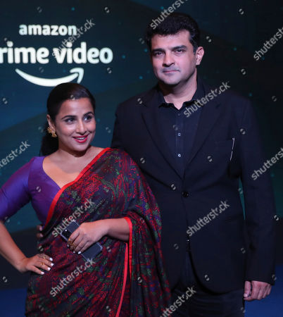 Bollywood actress Vidya Balan, left, along with her husband Siddharth Roy Kapur poses for photographs during a blue carpet event organized by Amazon Prime Video in Mumbai, India
