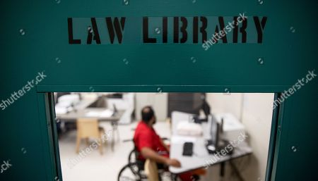 A detainee works on a computer in the law library at the Stewart Detention Center, in Lumpkin, Ga. The Stewart Detention Center sits in Lumpkin, a rural town about 140 miles southwest of Atlanta and right next to the Georgia-Alabama state line. The city's 1,172 residents are outnumbered by the roughly 1,650 male detainees that U.S. Immigration and Customs Enforcement said were being held in the detention center in late November