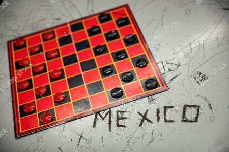 A checker board sits on a table in a pod at the Stewart Detention Center, in Lumpkin, Ga. The Stewart Detention Center sits in Lumpkin, a rural town about 140 miles southwest of Atlanta and right next to the Georgia-Alabama state line. The city's 1,172 residents are outnumbered by the roughly 1,650 male detainees that U.S. Immigration and Customs Enforcement said were being held in the detention center in late November