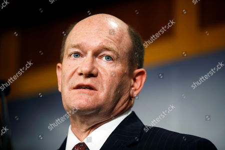 Sen. Chris Coons, D-Del., talks to reporters about the impeachment trial of President Donald Trump on charges of abuse of power and obstruction of Congress, at the Capitol in Washington