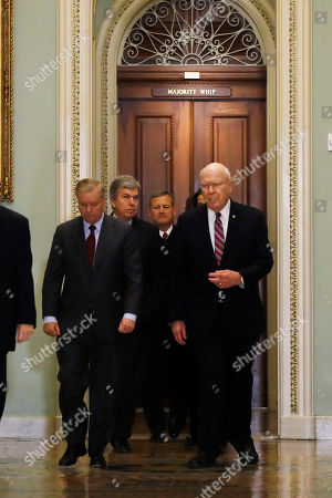 Supreme Court Chief Justice John Roberts is escorted by Sen. Lindsey Graham, R-S.C., left, Sen. Patrick Leahy, D-Vt., right, Sen. Dianne Feinstein, D-Calif., and Sen. Roy Blunt, R-Mo., toward the Senate chamber at the U.S. Capitol in Washington