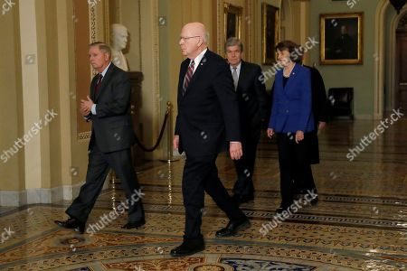 Sen. Lindsey Graham, R-S.C., left, Sen. Patrick Leahy, D-Vt., center left, Sen. Roy Blunt, R-Mo., center right, and Sen. Dianne Feinstein, D-Calif., walk in front of Chief Justice of the United States John Roberts as they arrive at the Senate chambers on Capitol Hill in Washington