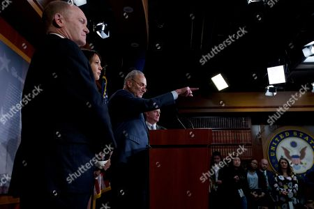 Chuck Schumer, Chris Coons, Kamala Harris, hris Van Hollen. Senate Minority Leader Chuck Schumer, D-N.Y., accompanied by Sen. Chris Coons, D-Del., Sen. Kamala Harris D-Calif. and Sen. Chris Van Hollen, D-Md., speaks during a news conference on Capitol Hill in Washington