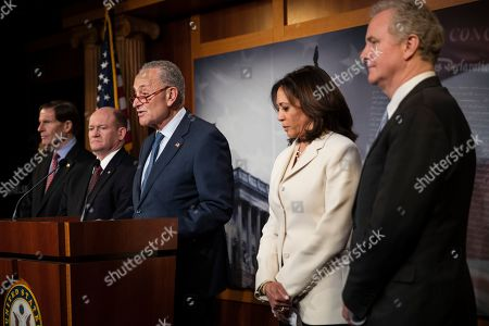 Democratic leader Sen. Chuck Schumer, D-N.Y., talk to reporters about the impeachment trial of President Donald Trump on charges of abuse of power and obstruction of Congress, at the Capitol in Washington, . With Schumer from left is Sen. Richard Blumenthal, D-Conn., Sen. Chris Coons, D-Del., Schumer, Sen. Kamala Harris, D-Calif., and Sen. Chris Von Hollen, D-Md