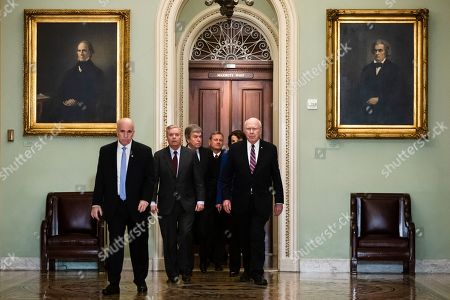 Supreme Court Chief Justice John Roberts is escorted by Sen. Lindsey Graham, R-S.C., center left, Sen. Patrick Leahy, D-Vt., right, Sen. Dianne Feinstein, D-Calif., and Sen. Roy Blunt, R-Mo., toward the Senate chamber at the U.S. Capitol in Washington