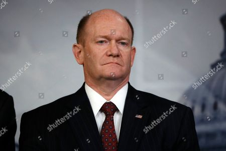 Sen. Chris Coons, D-Del., a member of the Foreign Relations Committee, attends a news conference talking about the impeachment trial of President Donald Trump on charges of abuse of power and obstruction of Congress, at the Capitol in Washington