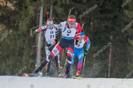 RUHPOLDING, GERMANY - : Simon Eder of Austria, Florent Claude of Belgium and Evgeniy Garanichev of Russian Federation at the IBU World Cup Biathlon, Man 10 KM Sprint at the Chiemgau Arena on in Ruhpolding, Germany. (Photo by Horst Ettensberger/ESPA-Images)