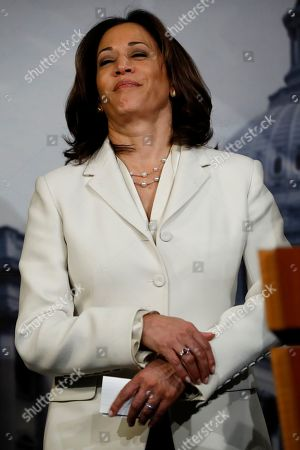 Sen. Kamala Harris, D-Calif., a member of the Senate Judiciary Committee, reacts as Sen. Richard Blumenthal, D-Conn., a member of the Senate Judiciary Committee, speaks during a news conference talking about the impeachment trial of President Donald Trump on charges of abuse of power and obstruction of Congress, at the Capitol in Washington