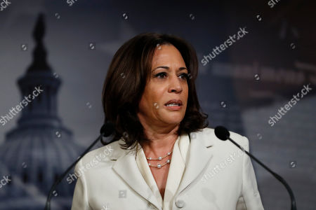 Sen. Kamala Harris, D-Calif., a member of the Senate Judiciary Committee, talks to reporters about the impeachment trial of President Donald Trump on charges of abuse of power and obstruction of Congress, at the Capitol in Washington