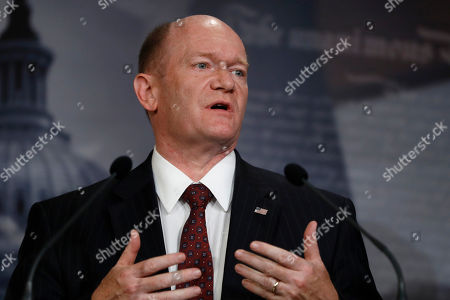 Sen. Chris Coons, D-Del., a member of the Foreign Relations Committee, talks to reporters about the impeachment trial of President Donald Trump on charges of abuse of power and obstruction of Congress, at the Capitol in Washington