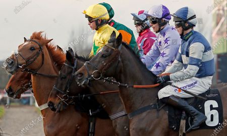 Runners gather for the start of The Racing TV Handicap Chase won by BALGEMMOIS (yellow, James Bowen) Market Rasen