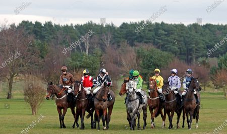 Runners gather for the start of The Racing TV Handicap Chase won by BALGEMMOIS (3rd right, James Bowen) Market Rasen