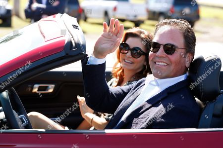 Stock Photo of Mike Piazza, Alicia Piazza. Former New York Mets catcher Mike Piazza and his wife Alicia wave as they drive down newly named Piazza Dr., after a ceremony in front of the Mets spring training facility, in Port St. Lucie, Fla