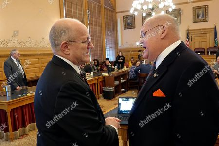 Larry Campbell, John Skubal. Larry Campbell, left, Kansas Gov. Laura Kelly's budget director, confers with state Sen. John Skubal, R-Overland Park, before outlining Kelly's spending proposals to a joint meeting of the House and Senate budget committees, at the Statehouse in Topeka, Kan. Kelly is proposing that the state burn through more than its $1.1 billion in cash reserves to pay off state debt early
