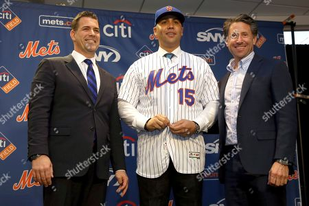 Carlos Beltran, Jeff Wilpon, Brodie Van Wagenen. New New York Mets manager, Carlos Beltran, center, poses for a picture with general manager Brodie Van Wagenen, left, and Mets COO Jeff Wilpon during a baseball news conference at Citi Field in New York. Beltran is out as manager of the Mets. The team announced the move