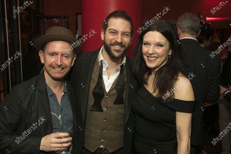 Stock Picture of Ian Hughes (Thenardier), Jon Robyns (Jean Valjean) and Josefina Gabrielle (Madame Thenardier)