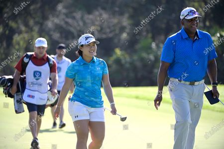 Stock Picture of Nasa Hataoka of Japan shares a laugh with her playing partner, former professional baseball player Joe Carter, while walking to the 13th hole during the first round of the LPGA Diamond Resorts Tournament of Champions at the Tranquilo Golf Course at Four Seasons Golf and Sports Club in Lake Buena Vista, Florida, USA, 16 January 2020. The tournament features a 'winners-only' field from the previous two years.