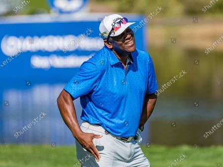 Stock Photo of Lake Buena Vista, FL, U.S: Former MLB player Joe Carter reacts to his shot onto the 18th green during 1st round of Diamond Resorts Tournament of Champions Presented by Insurance Office of America held at Tranquilo Golf Course at Four Seasons Golf and Sports Club Orlando in Lake Buena Vista, Fla