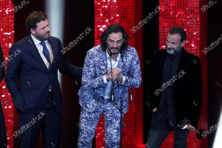 Spanish film director Alfonso Corte-Cavanillas (R), screenwriter Juan Carlos Diaz (L) and actor Asier Etxeandia (C) receive the Special award during the 2020 Premios Feroz (Feroz Awards) ceremony at the Teatro Auditorio Ciudad de Alcobendas in Madrid, Spain, 16 January 2020.