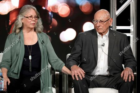 """Founders of SurvivorsEmpowered.com Sandy Phillips, left, and Lonnie Phillips hold hands as they appear at the Investigation Discovery's """"In Memoriam"""" panel during the Discovery Network TCA 2020 Winter Press Tour at the Langham Huntington, in Pasadena, Calif"""