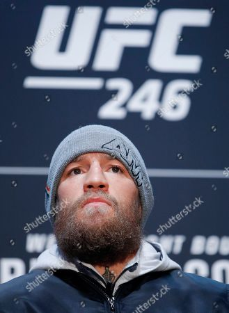 """Conor McGregor listens to a question during a media event for the UFC 246 mixed martial arts bout, in Las Vegas. McGregor is scheduled to fight Donald """"Cowboy"""" Cerrone in a welterweight bout Saturday in Las Vegas"""