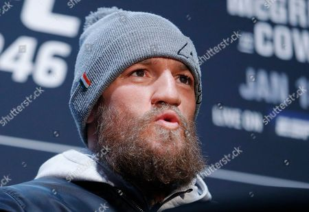 """Conor McGregor reacts during a media event for the UFC 246 mixed martial arts bout, in Las Vegas. McGregor is scheduled to fight Donald """"Cowboy"""" Cerrone in a welterweight bout Saturday in Las Vegas"""