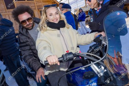 Stock Picture of Chloe Jouannet and Nicolas Benamou on a skidoo