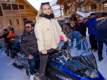 Chloe Jouannet and Nicolas Benamou on a skidoo