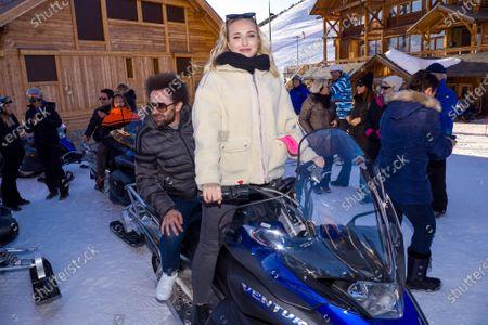 Stock Photo of Chloe Jouannet and Nicolas Benamou on a skidoo