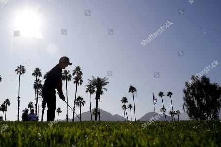 Francesco Molinari putts on the third hole during the first round of The American Express golf tournament at La Quinta Country Club, in La Quinta, Calif