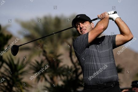 Francesco Molinari hits from the sixth tee during the first round of the American Express golf tournament at La Quinta Country Club, in La Quinta, Calif