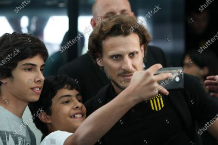 The head coach of Uruguayan soccer team Penarol, former soccer player Diego Forlan (R), poses with fans upon his arrival at Carrasco International airport in Montevideo, Uruguay, 16 January 2020. Penarol travel to the US as part of an international friendlies matches against Seattle Sounders and Los Angeles F.C.