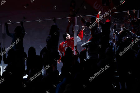 Stock Picture of Florida Panthers center Brian Boyle (9) gives away an autographed stick after an NHL hockey game against the, in Sunrise, Fla