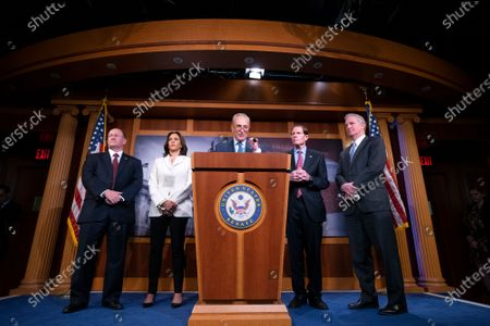 United States Senate Minority Leader Chuck Schumer (Democrat of New York), joined by United States Senator Richard Blumenthal (Democrat of Connecticut), United States Senator Chris Van Hollen (Democrat of Maryland), United States Senator Kamala Harris (Democrat of California), and United States Senator Christopher A. Coons (Democrat of Delaware), delivers remarks on the impeachment trial after United States Supreme Court Chief Justice John Roberts swore in Senators as impeachment jurors at the United States Capitol in Washington DC.