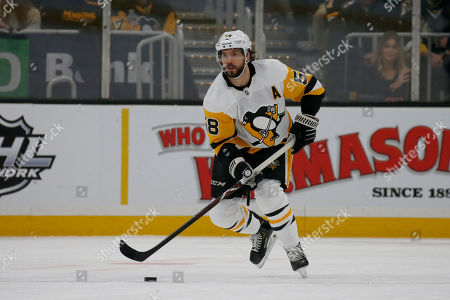 Stock Image of Pittsburgh Penguins defenseman Kris Letang (58) looks to pass up the ice during the first period of an NHL hockey game against the Boston Bruins, in Boston