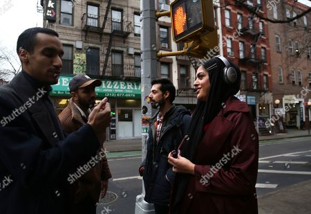 College friends and acquaintances, from left, Ahmed Ayoub, Mohammed Ali, Saad Khan and Amani al-Khatahtbeh, founder of Muslimgirl.com, talk on the streets of Greenwich Village after attending Friday Prayer at the Islamic Center of New York University, in New York