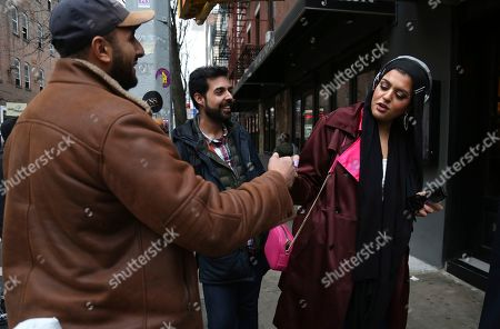 Stock Picture of Old college friends and acquaintances Mohammed Ali, left, of Stanton Island, and Saad Khan, center, of New Jersey, talk with Amani Al-Khatahtbeh, founder of Muslimgirl.com, right, after Friday Prayer at the Islamic Center of New York University, in New York
