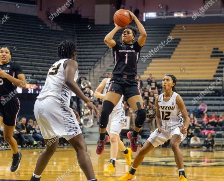 South Carolina's Zia Cooke, center, shoots between Missouri's Amber Smith, left, and Elle Brown, right, during the second half of an NCAA college basketball game, in Columbia, Mo. South Carolina won the game 78-45