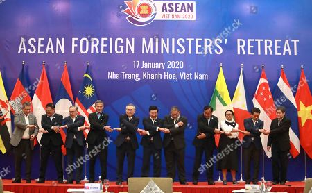 Association of Southeast Asian Nations, ASEAN, foreign ministers from left: Malaysian Foreign Minister Saifuddin Abdullah, Myanmar Foreign Minister U Kyaw Tin, Philippine Foreign Secretary Teodoro Locsin Jr., Singaporean Foreign Minister Vivian Balakrishnan, Thai Foreign Minister Don Pramudwinai, Vienamese Foreign Minister Pham Binh Minh, Brunei Foreign Minister Erywan Yusof, Cambodian Foreign Minister Prak Sokhonn, Indonesian Foreign Minister Retno Marsudi, Laos Foreign Minister Saleumxay Kommasith and ASEAN Secretary General Lim Jock Hoi pose for a group photo in Nha Trang, Vietnam on . The ministers hold their annual retreat to discuss regional and international issues and to set out priorities for the rest of the year, in which Vietnam holds the rotating chair of the bloc