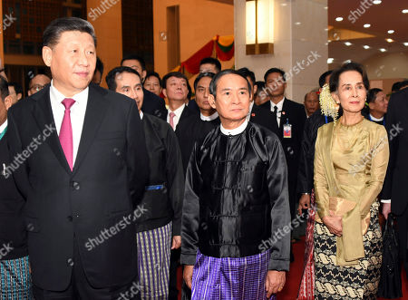 Provided by Myanmar News Agency (MNA), Chinese President Xi Jingping, left, Myanmar President Win Myint, center, and Myanmar leader Aung San Suu Kyi, right, attend a ceremony to mark the Myanmar-China 70th Anniversary of Establishment of Diplomatic Relations in Naypyitaw, Myanmar