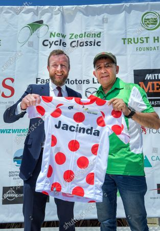 MP Kieran McAnulty is presented with a KOM jersey for Prime Minister Jacinda Arden by race director Jorge Sandoval (right). Stage three of the NZ Cycle Classic UCI Oceania Tour (Martinborough circuit)