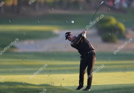 England's Danny Willett plays a shot on the 10th fairway during the second round of the Abu Dhabi Championship golf tournament in Abu Dhabi, United Arab Emirates