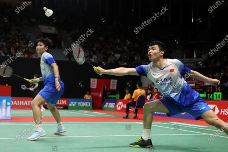Huang Dongping (L) and Wang Yilyu (R) of China in action during the Mix Double qualifying match against Chris Adcock and Gabrielle Adcock of Denmark (not pictured) at the Daihatsu Indonesian Masters badminton tournament in Jakarta, Indonesia, 17 January 2020.