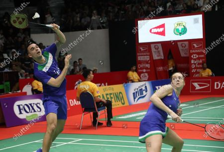 Chris Adcock (L) and Gabrielle Adcock (R) of Denmark in action against Huang Dongping  and Wang Yilyu of China (not pictured) during the Mix Double qualifying match at the Daihatsu Indonesian Masters badminton tournament in Jakarta, Indonesia, 17 January 2020.