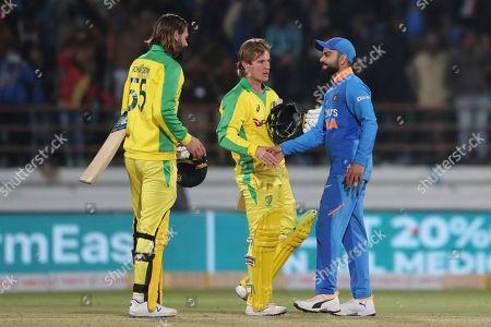 India's captain Virat Kohli, right, shakes hand with Australia's Adam Zampa after India won the second one-day international cricket match in Rajkot, India