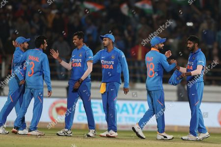 India's captain Virat Kohli, second right, along with teammates celebrate their victory in the second one-day international cricket match against Australia in Rajkot, India