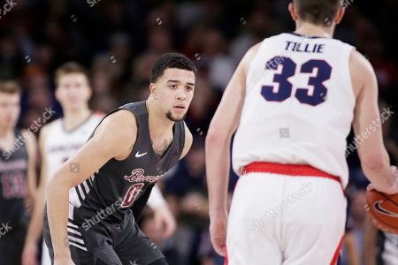 Stock Picture of Santa Clara forward DJ Mitchell (0) defends Gonzaga forward Killian Tillie (33) during the first half of an NCAA college basketball game in Spokane, Wash