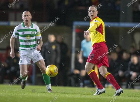 Stock Image of Partick Thistle v Celtic... 18th January 2020.Patick Thistle Kenny Miller (right) and Celtic's Scott Brown (left)