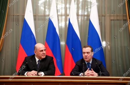 Stock Photo of Russian Prime Minister Mikhail Mishustin (L) and Russian former prime minister and deputy head of the Russian Security Council Dmitry Medvedev (R) attend a meeting with  Russian government acting members at Russia's Government headquarters in Moscow, Russia, 17 January 2020.