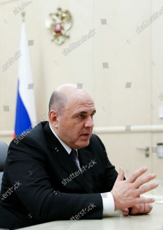 Stock Picture of Russian Prime Minister Mikhail Mishustin attends a meeting with former prime minister and deputy head of the Russian Security Council Dmitry Medvedev (not pictured) at Russia's Government headquarters in Moscow, Russia, 17 January 2020.